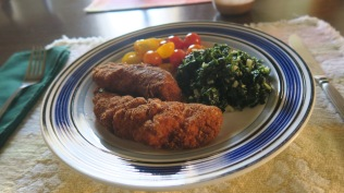 Chicken tenders done like cutlets with spinach and garlic and cherry tomatoes from the garden.